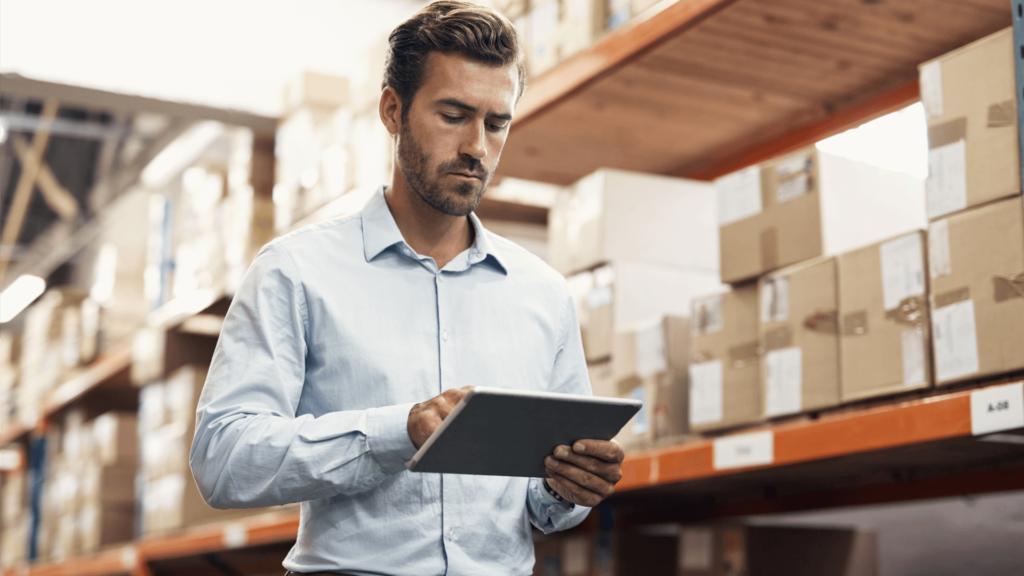man reviewing shipping software